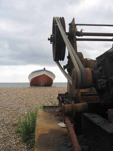 Fishing boat and winch on the seashore